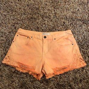 Free People - orange shorts, lace side, size 30